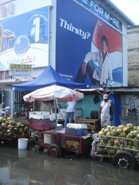 coconut vendor thirsty for change – bus park Stabroek GeorgetownGuyana