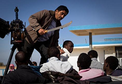 libya after gadaffi. what's he doing with that machete you ask?