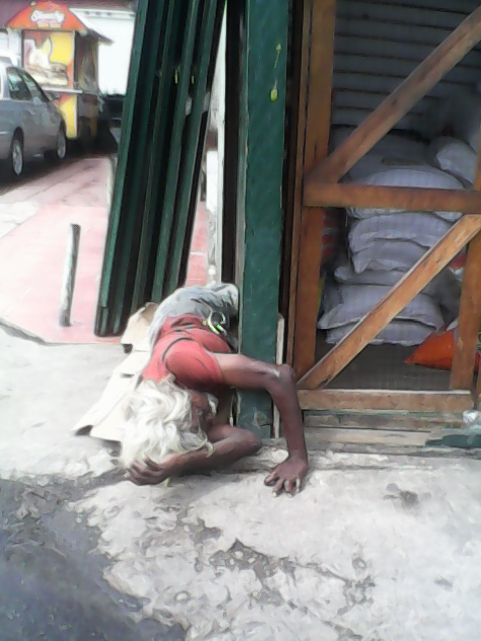man sleeping on ground - stabroek market