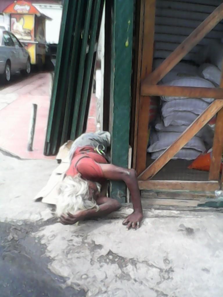 man sleeping on ground - stabroek market
