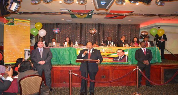 moses nagamootoo with guyana and trini flag in new york