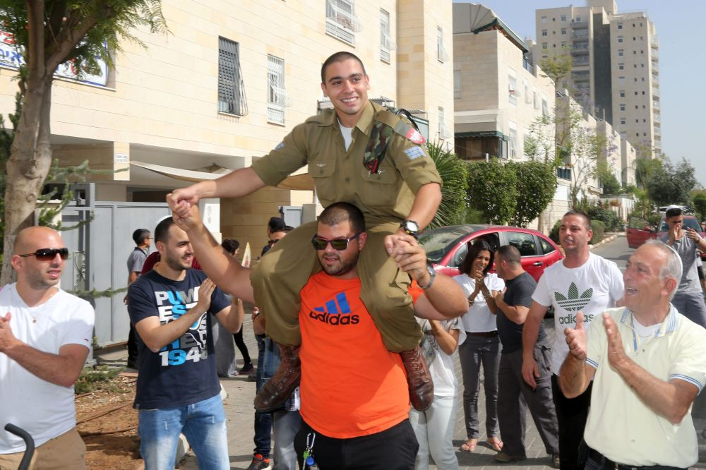 IDF medic Elor Azaria being feted in his hometown of Ramla after his release from detention for Passover. Azaria was awaiting trial for the execution of Abdel-Fattah al-Sharifwho was prone and motionless on the ground after being shot and wounded following a stabbing attack on an Israeli soldier in Tal Rumayda in Hebron. (22 April, Stringer/AFP/ Getty Images)