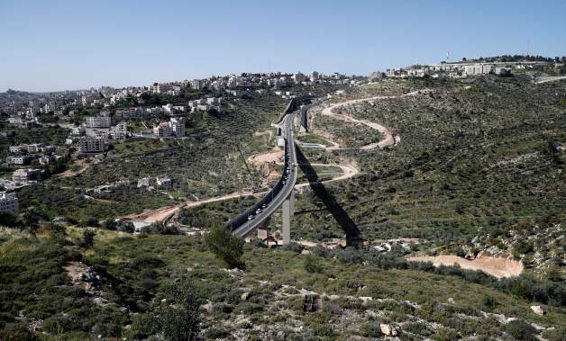 Despite legal appeals by Palestinians, construction continues on the separation wall under a bypass road outside Beit Jala. (7 April, Thomas Coex/AFP/Getty Images)